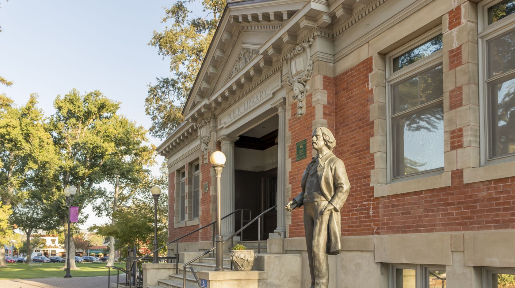 A Statue In Front Of A Brick Building